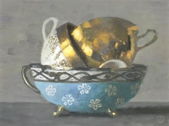 """""""Elegant Still Life of Three Stacked Cups, One Gold, One White, One Blue"""""""