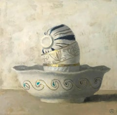 """Elegant still Life of Three Cups in White, Blue and Gold Stacked in Bowl"""