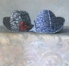 """Elegant Still Life of Two Blue and White Hats with Red Flower"""