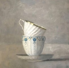 """""""Elegant Still Life of Two Stacked Cups in White, Blue and Gold on Gray"""""""