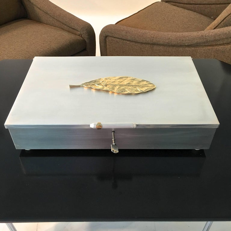 Extra large sterling silver cigar humidor prototype custom-made by a renowned gunsmith. Measures: 18 inches wide by 12 inches deep by 4 inches high on four bone feet. Sterling silver on all six sides of the lidded hinged box, even the