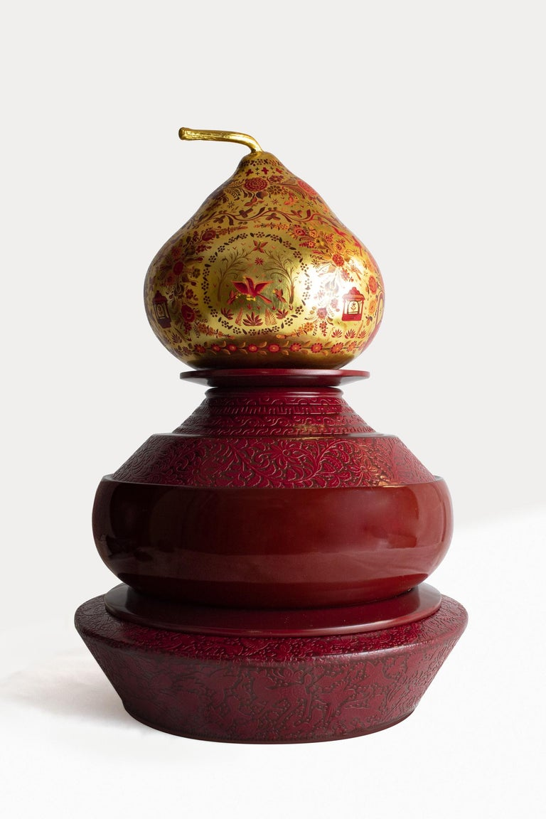 Three urns, two trays, one gourd. Turned solid tzalam (wild tamarind) wood; maque and lacquer carving; gold leaf; oil painting.  Commemoration, ceremony, and veneration of the ancestral are acts of a deeply personal, familial nature. Far removed