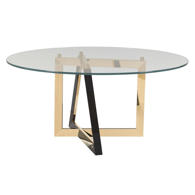 Dining tabletop in tempered ultra clear glass. Base in solid beech, black stained with high-gloss finish. Inlay metal details in polished brass with a high-gloss finish.