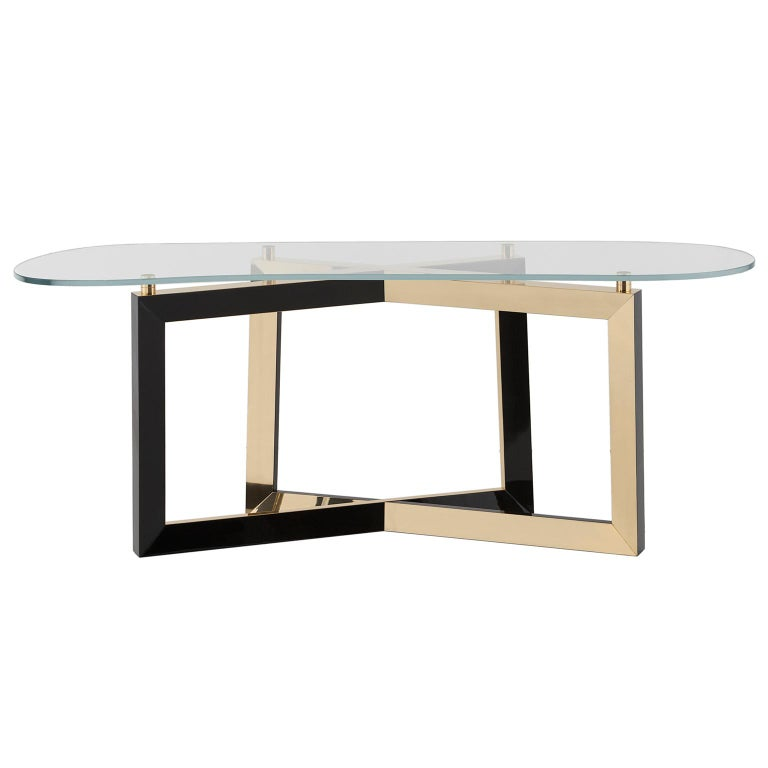 Console top in tempered ultra clear glass. Base in solid beech, black stained with high-gloss finish. Inlay metal details in polished brass with a high-gloss finish.