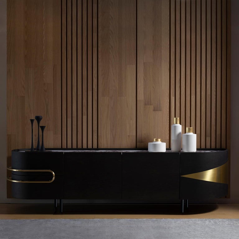 Sideboard in American oak veneer, open-pore dark brown stained with matt finish. Top in polished Calacatta Viola marble. Contains drawers and shelf compartments and interior LED lighting triggered on door opening. Inlay metal details and handles in