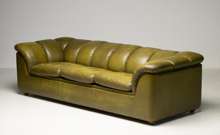Distinctive Poltrona Frau Cocker sofa from the premium collection in the late 1970s. (source: Poltrona Frau, Italy) This long and low down-filled 3-seat is designed by Franco Bresciani. The supple leather has acquired the right amount of patina to
