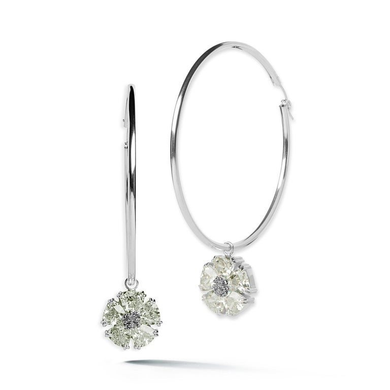 Designed in NYC  .925 Sterling Silver 10 x 7 mm Olive Peridot Blossom Stone Dangle Hoops. Big dangle hoops take on an edgy elegance with beautiful blossom with stones dangling. Blossom stone dangle hoops:   Sterling silver  High-polish