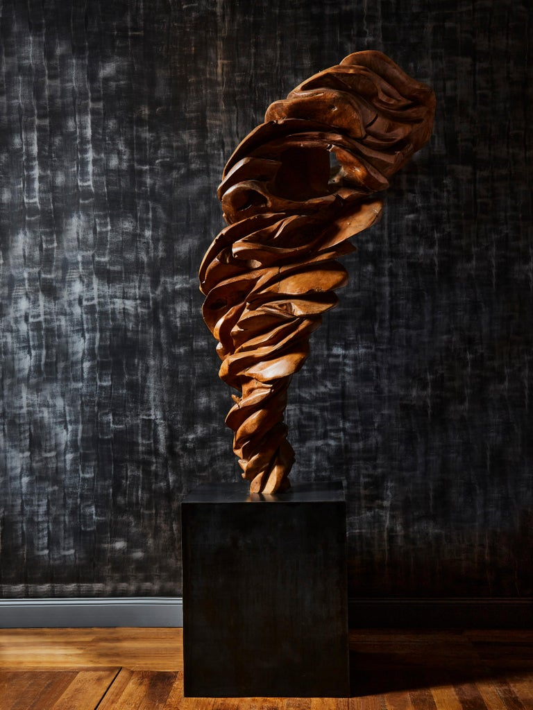 Amazing wooden sculpture in olive wood on a patinated steel base. The base has been custom made by Studio Glustin, France, 1980s.