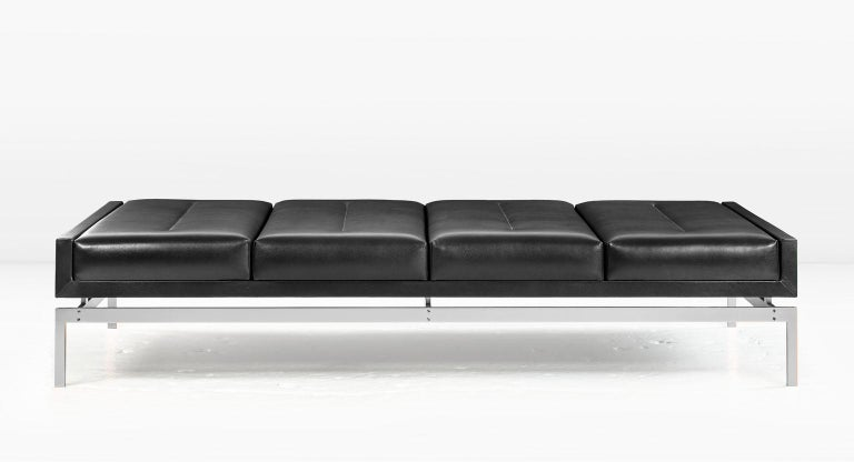 With seating on all sides, the Olivera becomes the natural focus of any room. Shown with a nickel base and black leather. Available in other metals. COM or COL (Customer's own fabric or leather. Fabric / leather not included in the price). Designed
