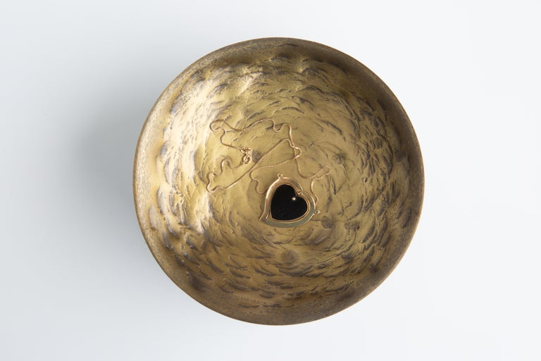 This simple, sophisticated round design is an organically hand-hammered brass valet tray which has versatile uses.  Each piece is handmade. Hammering/markings will vary from piece to piece. For indoor use only.  Customization available. Please