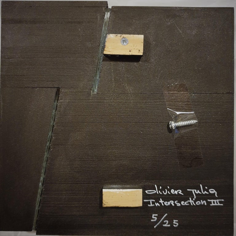Intersection III 5/25 is one of a series of four different small size contemporary modern sculpture painting reliefs by French-Dutch artist Olivier Julia. This relief is made from wood, fiberboard, a small strip of glass and it is finished with a