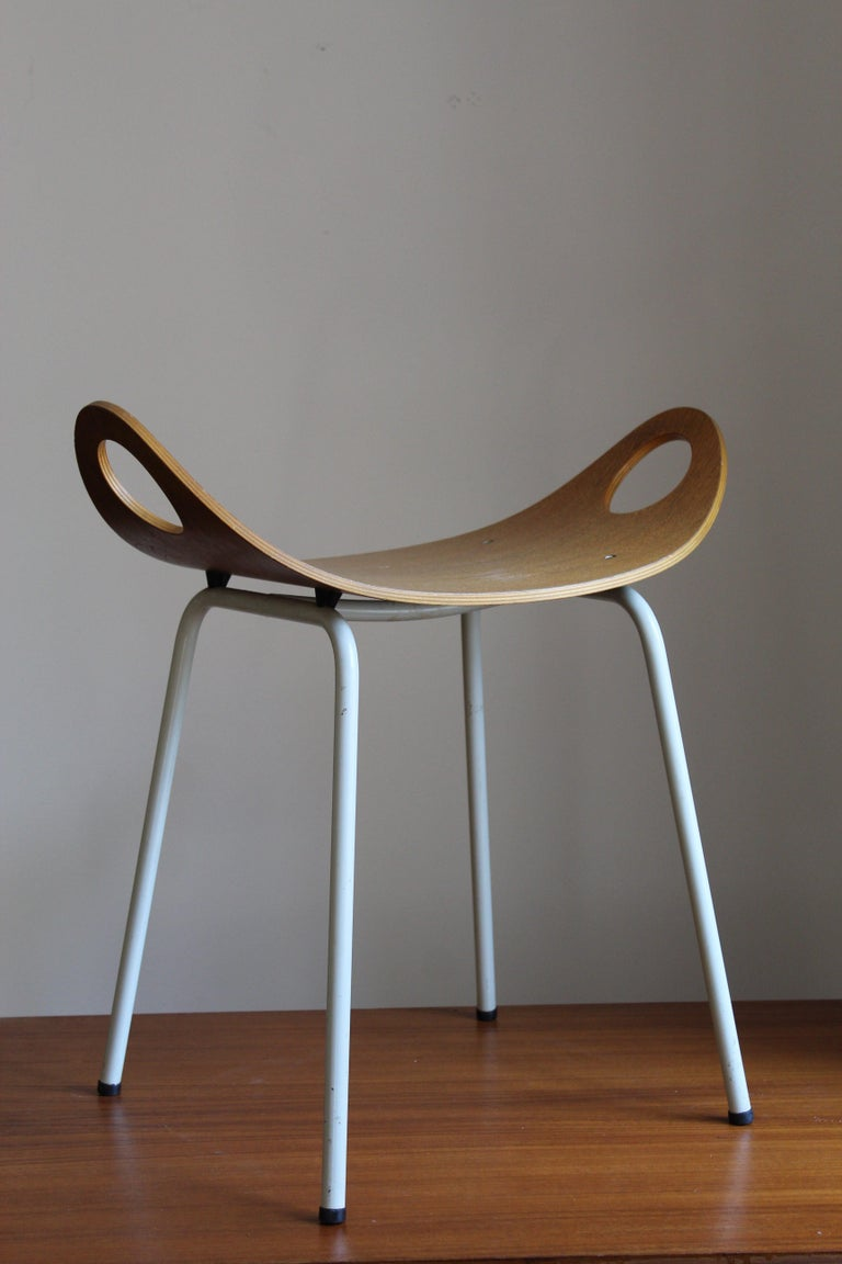 A rare stool, designed by Olof Kettunen, for J. Merivaara Oy, Finland 1950s.   In plywood and original lacquered metal.  Other designers of the period include Paavo Tynell, Alvar Aalto, Charlotte Perriand, Jean Prouvé, and Isamu Noguchi.