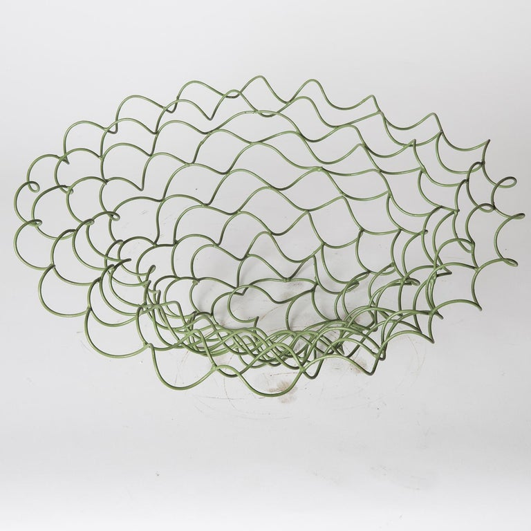 This sculptural vase by Sciortino is formed of tempered iron wire with a painted finish of various shades of green, lending the unruly geometry of the piece a distinct vivacity. Product dimensions may vary slightly.