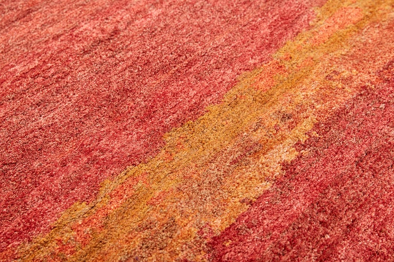The Oltre carpets by MarCo Carini present a natural weave, both hand knotted with 100 knots per sqm The chosen colors for this project are blend of tea, violet, wisteria, periwinkle, saffron and dandelion, Inspired by Mark Rothko's paintings,
