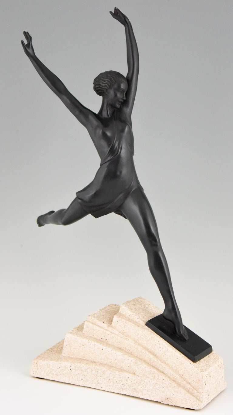 Olypme, elegant Art Deco sculpture of a running girl by Fayral, pseudonym of Pierre le Faguays cast by the Max le Verrier foundry. Green patinated art metal on a stone base, France, 1930.