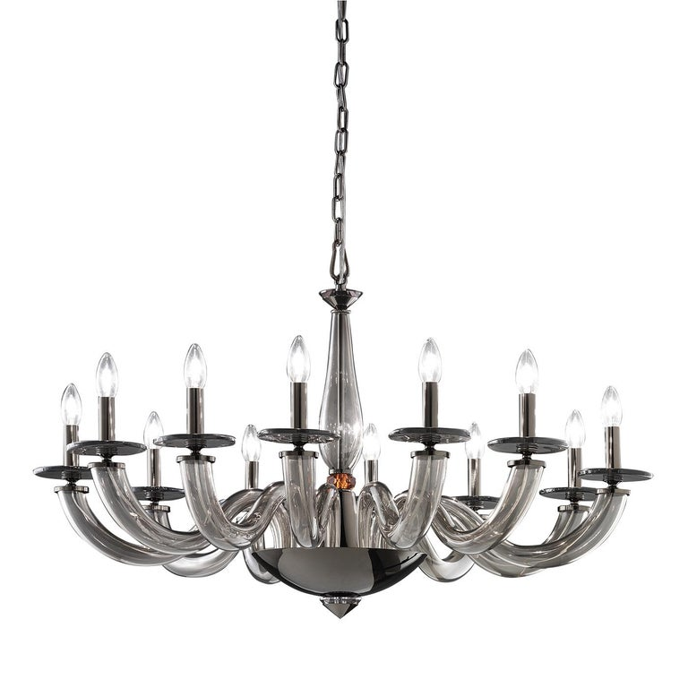 This exquisite chandelier harmoniously combines traditional craftsmanship and contemporary design. Entirely crafted of smoky-gray, mouth-blown Murano glass, the elongated central body with a crystal topaz sphere accent is supported by a shiny metal