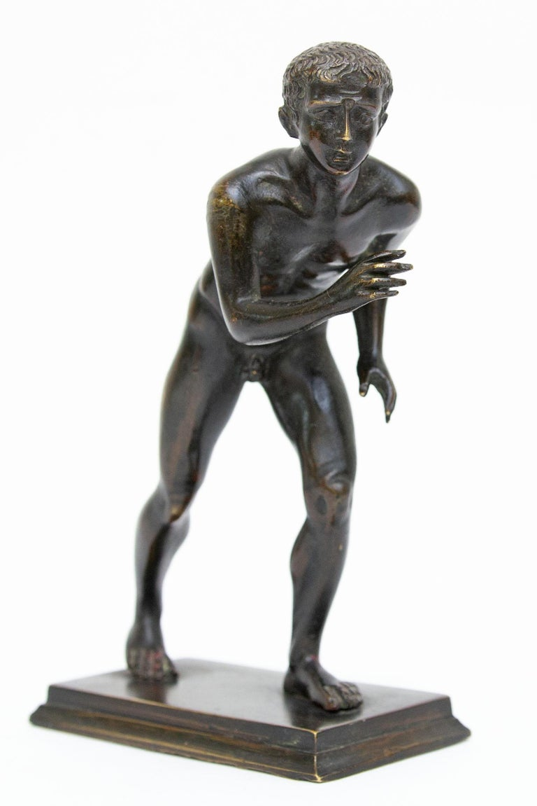 Antique bronze sculpture. The Herculaneum runner. After the antique model in the Villa of the Papyri, Herculaneum, now located in Neaples Royal Museum.