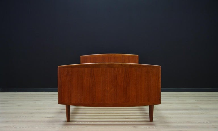 Scandinavian bed from the 1960s-1970s, a minimalistic form made for the Omann Jun manufacture. Construction veneered with teak, teak legs. Preserved in good condition (minor scratches and bruises) - directly for use.  Dimensions: height 65 cm,
