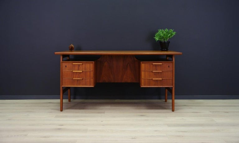 Classical desk from the 1960s-1970s, Scandinavian design produced in the Omann Jun manufacture, Gunni Omann project. Furniture veneered with teak. It has six capacious drawers, two bookshelves at the back of the bar. Preserved in good condition