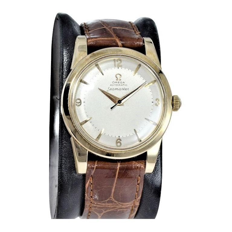 FACTORY / HOUSE:  Omega Watch Company STYLE / REFERENCE:  Seamaster Automatic / Ref. 2577 METAL / MATERIAL: 14Kt. Solid Yellow Gold CIRCA YEAR: 1950's DIMENSIONS: 43mm x 34mm MOVEMENT / CALIBER: Automatic Winding / 17 Jewels  DIAL / HANDS: Original
