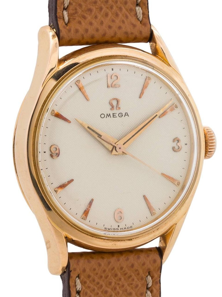 A beautiful treasure just recovered from storage in Europe. A stunning example vintage Omega 18K PG dress model ref# 114.66 871 movement serial #14.5 million circa 1955. Featuring a 35 x 42mm thick walled case with wide dome bezel, heavy contoured