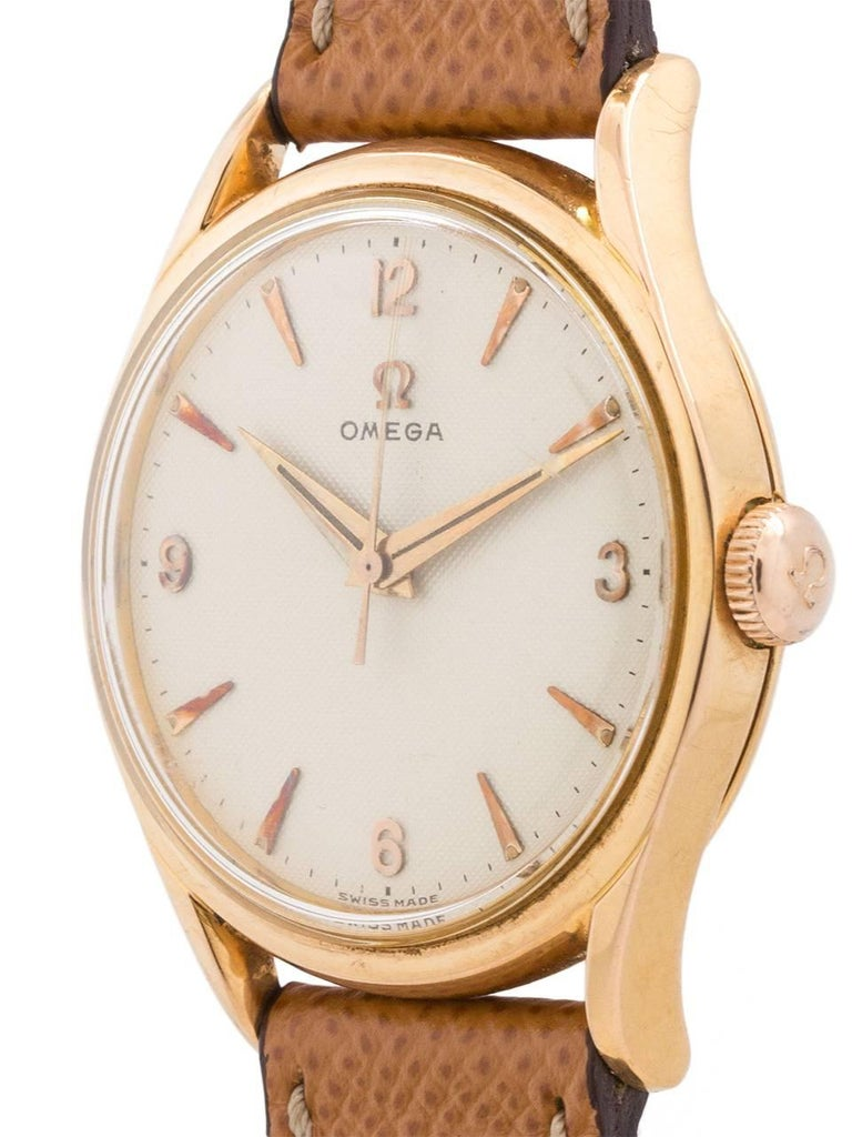 Omega Rose Gold Waffle Dial Manual Wind Dress Wristwatch, circa 1955 In Excellent Condition For Sale In West Hollywood, CA