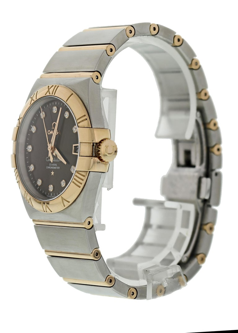 Omega Constellation 123.20.38.21.63.001 Co-axial Chronometer Men's Watch. 38mm Stainless Steel case. 18K Rose Gold bezel with engraved Roman numerals. Brown Dial Rose Gold luminous hands factory placed diamond hour markers. Minute markers around the