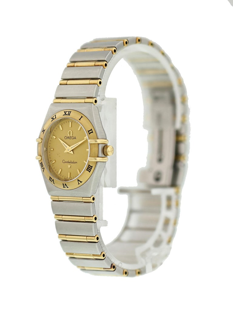 Omega Constellation 1272.10.00 Ladies Watch. 25mm stainless steel case. 18K yellow gold bezel with black Roman numeral hour markers. Champagne dial with gold-tone hands and hour markers. Minute marker around the outer dial. stainless steel and 18K
