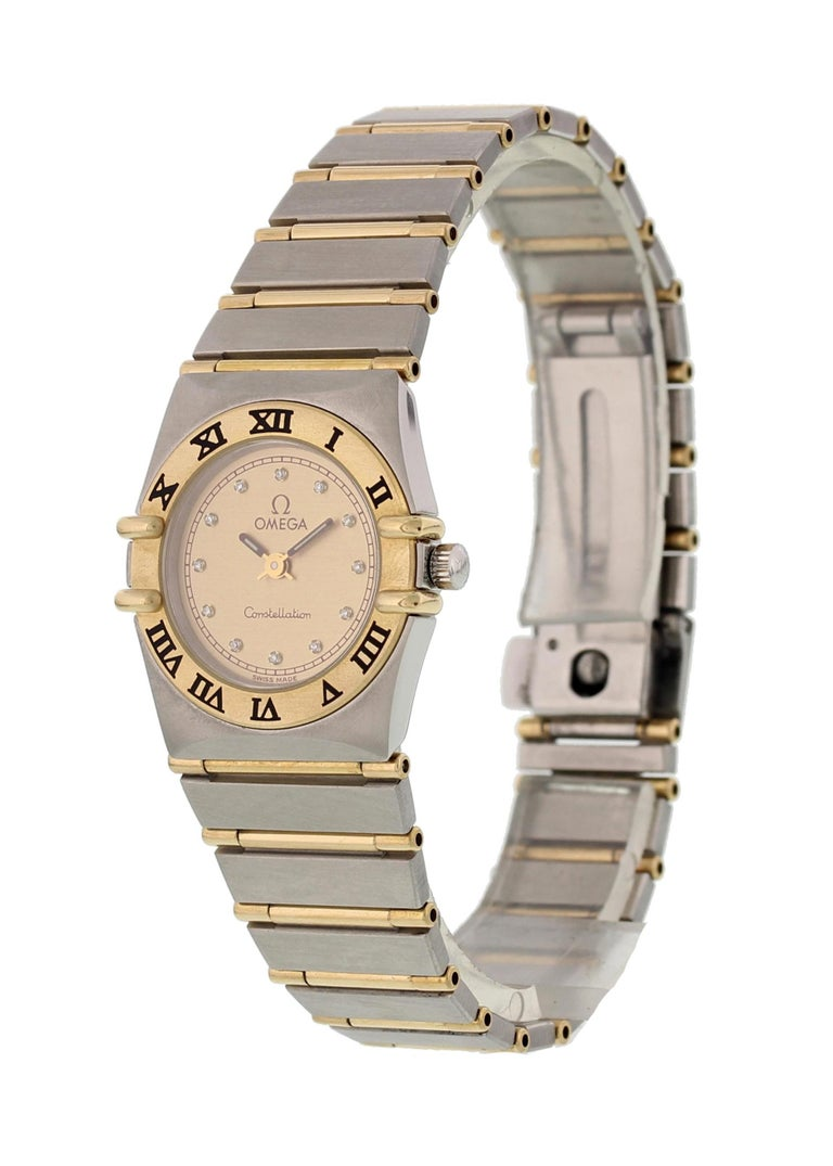 Omega Constellation Diamond Dial Ladies Watch. 23 mm stainless steel case with an 18k yellow gold crown. 18k yellow gold bezel. White dial with gold hands and markers. 18k yellow gold and stainless steel band with stainless steel fold-over clasp.