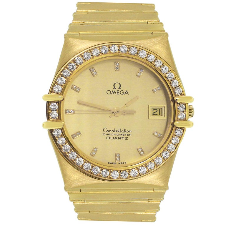 Brand: Omega Model: Constellation Case Material: 18k Yellow Gold Case Diameter: 23mm Crystal: Sapphire Bezel: 18k yellow gold diamond Factory bezel Dial: Factory diamond dial. Champagne dial with yellow gold hour markers and hands. Date is displayed