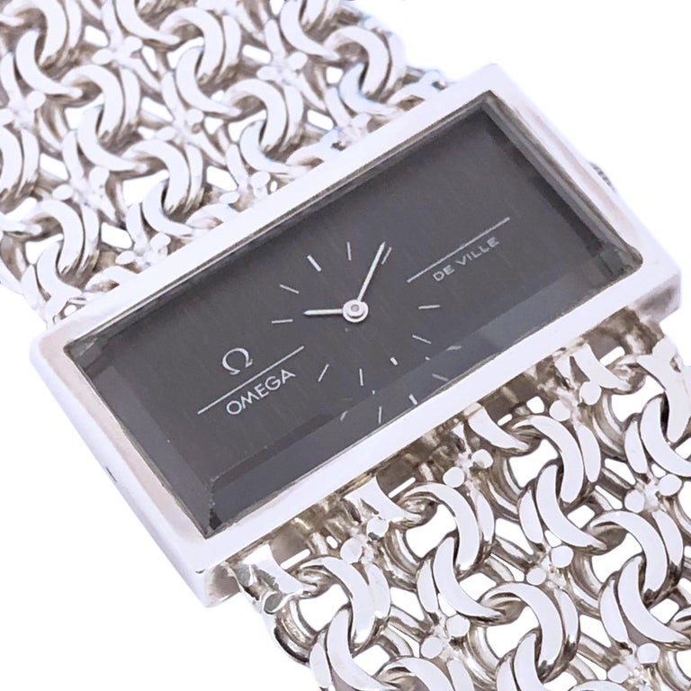 Omega De Ville Vintage Large Silver Mechanical Bracelet Watch In Excellent Condition For Sale In Chicago, IL