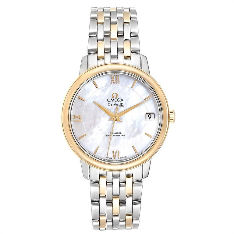 Omega DeVille Prestige Steel Yellow Gold Men's Watch 424.20.33.20.05.001. Automatic self-winding Co-Axial movement. Stainless steel and 18K yellow gold round case 32.7 mm in diameter. Yellow gold bezel. Domed scratch-resistant sapphire crystal with