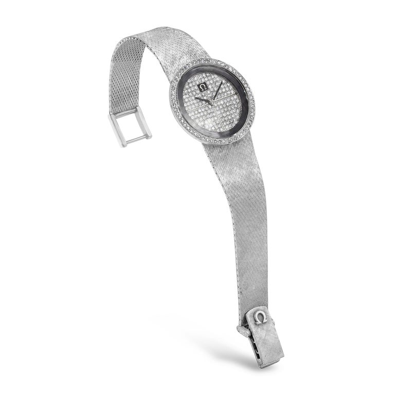 A unique diamond watch made by Omega. Showcasing a diamond encrusted dial and bezel, set in a snake bracelet made in 18 karat white gold. Diamonds weigh 2.00 carats total. Manual Wind Mechanical movement.