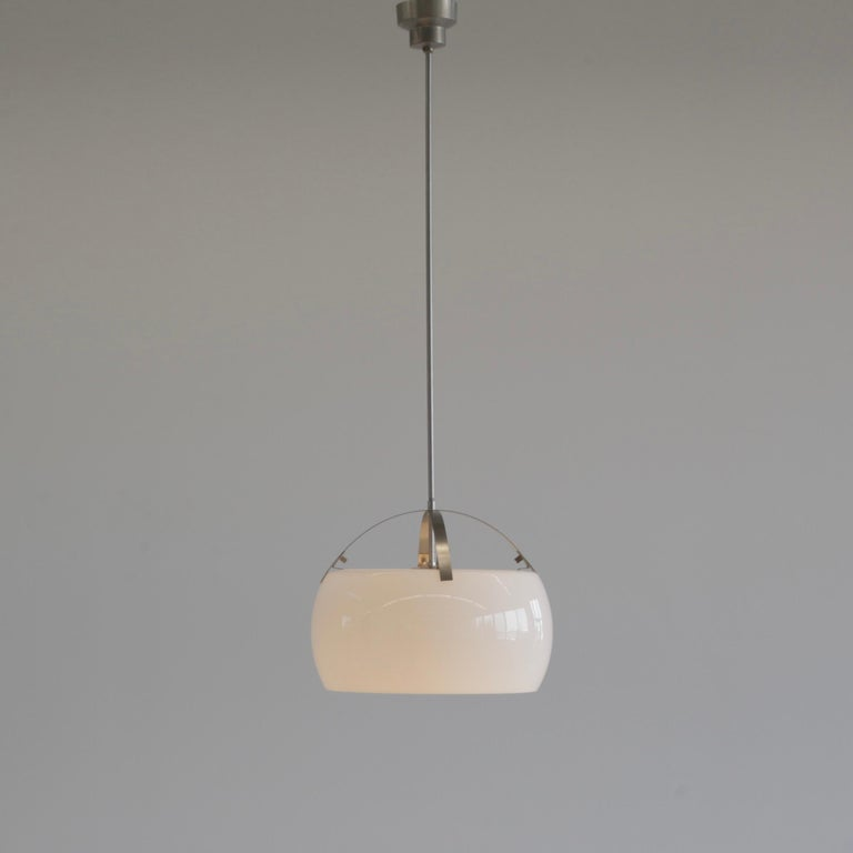 Hanging lamp designed by Vico Magistretti. Italy, Artemide, 1962.  The Omega lamp comprising of two separate pieces of opaline glass on a brushed metal frame.  We also have the XL size version (50 cm) available  Literature: Artemide catalogue