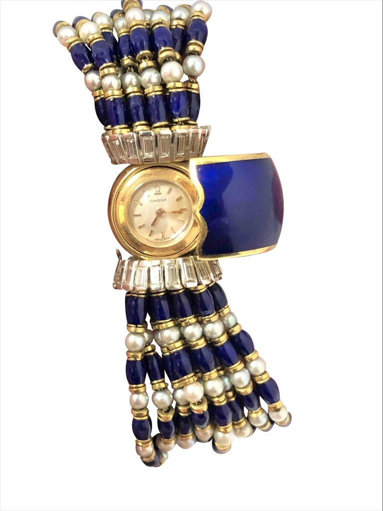 Circa 1970 Omega Very Scarce High Jewelry / watch Collection Covered Bracelet ladies Wrist Watch. A 17 Jewel manual Back wind Movement within an 18K Yellow Gold concealed case with Cobalt Blue Enamel flip cover, both sides of the watch case are set