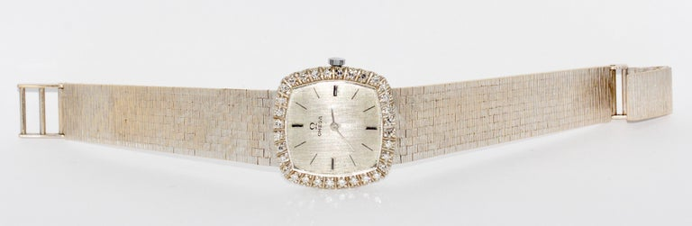 Omega Ladies Wrist Watch, 18 Karat White Gold and Diamonds, manual winding.  Including certificate of authenticity.