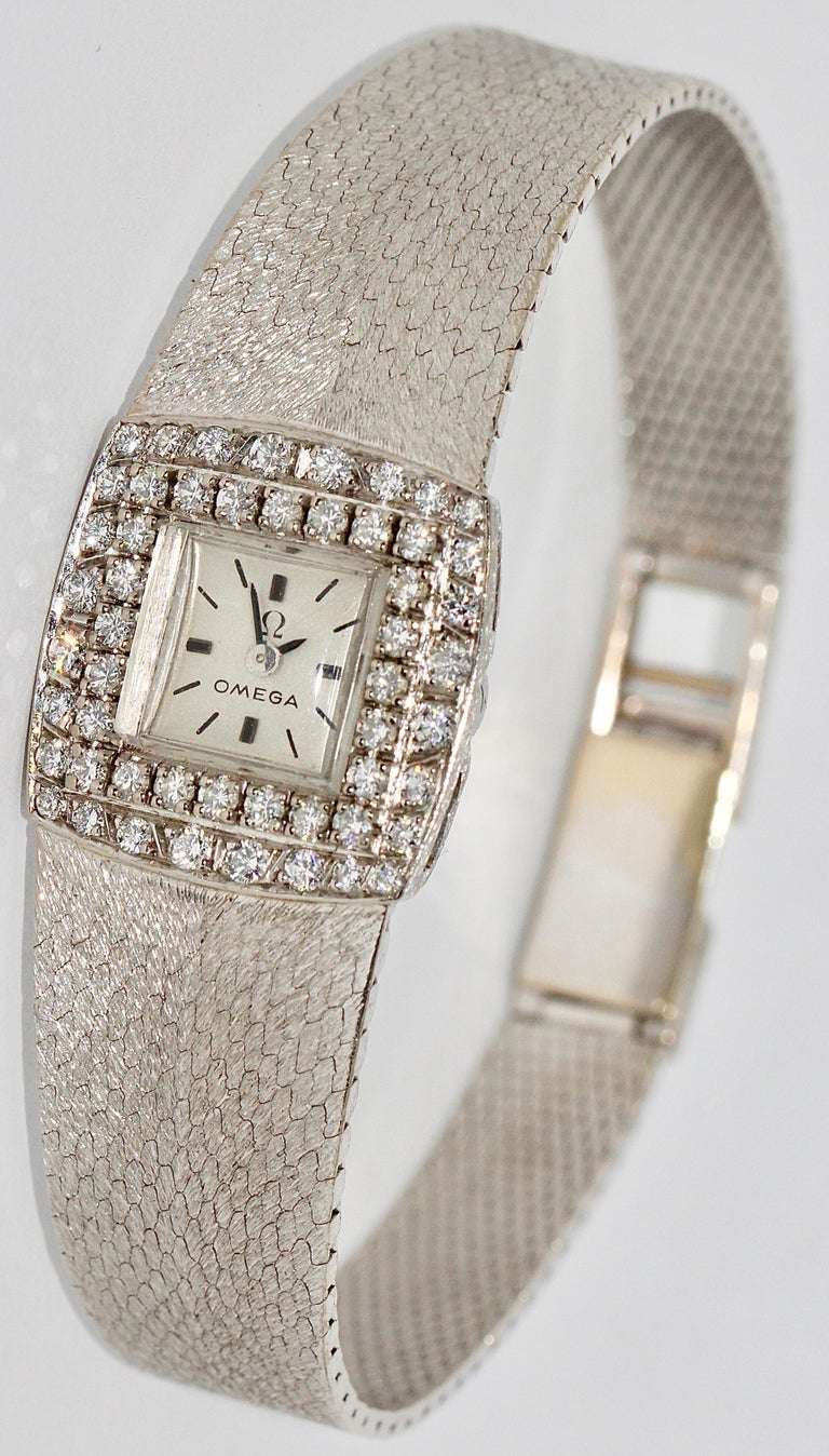 Omega Ladies Wristwatch, 18 Karat White Gold, with Diamonds.  Mechanical movement (manual wind). Very good condition.  Very rare model.  Including certificate of authenticity.