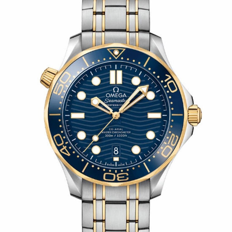 Omega Seamaster Reference #:__MISSING__. Unworn Men's Omega Seamaster 42mm 210.20.42.20.03.001 18k yellow gold/stainless steel strap, 18k yellow gold/stainless steel bezel, on blue face.. Verified and Certified by WatchFacts. 1 year warranty offered