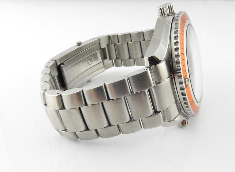Omega Seamaster Planet Ocean Men's Watch  Model: 2209.5 Serial: 81062357  42mm watch case  Black Dial  Orange Bezel  White luminescent markers and numbers at 6, 9, 12  Date  Automatic Movement  Fits up to 7.75