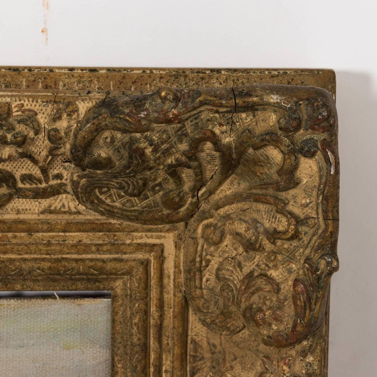 Beach scene with a young female figure in foreground. Oil on canvas, highly decorative carved frame. Signed in the right bottom corner