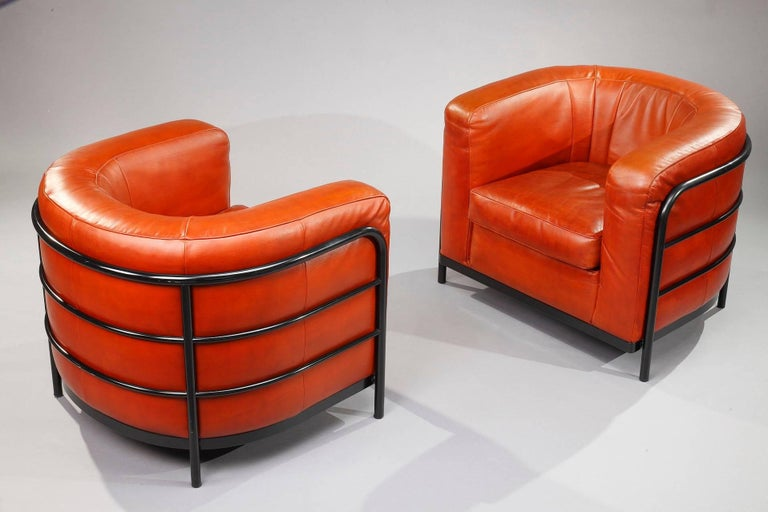 Onda living room set in orange leather featuring one two-seat sofa and two armchairs.