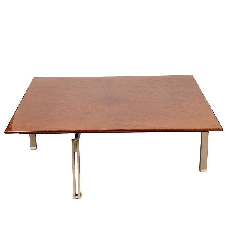 A gorgeous lacquered figured wood table with stainless brushed steel base. Two available at time of listing.