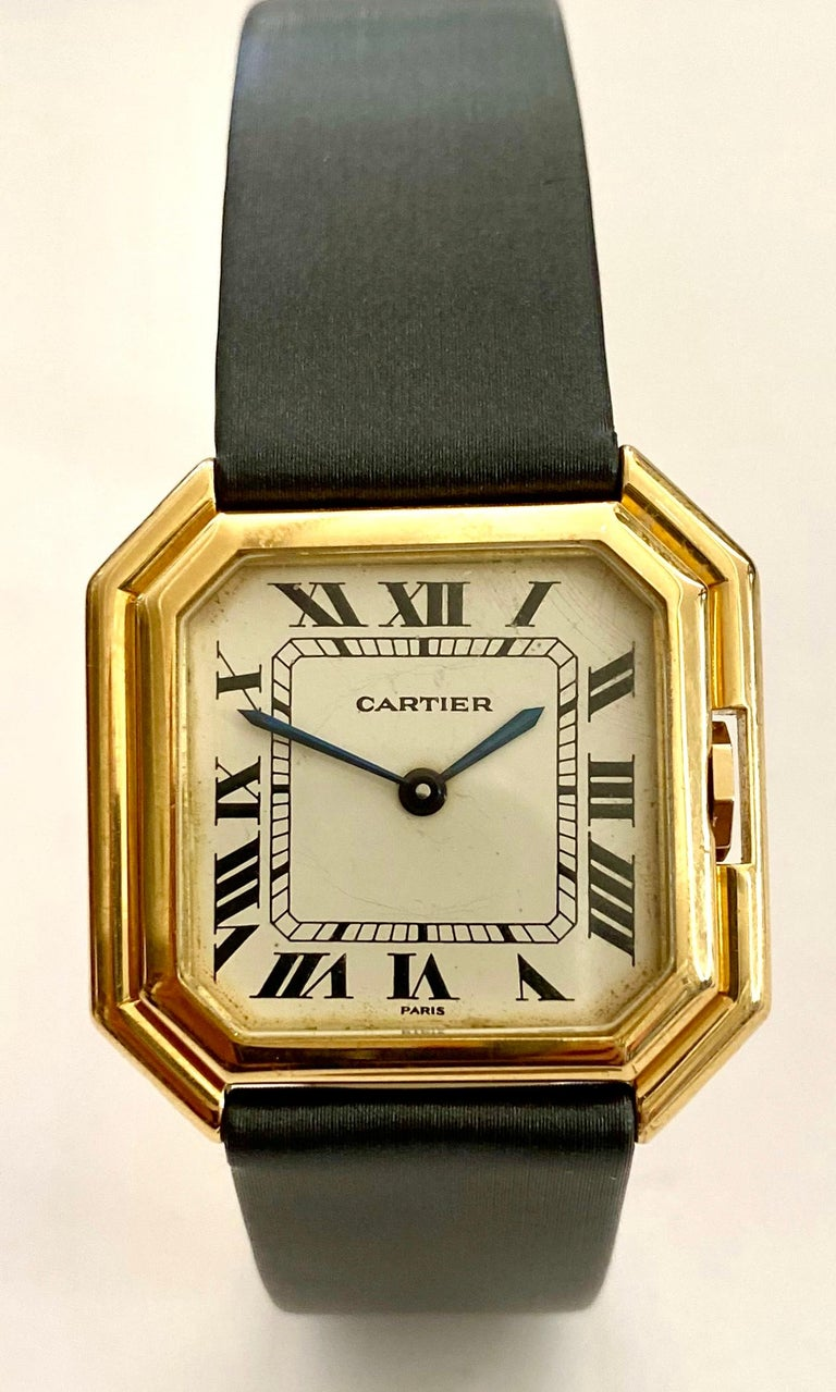 One (1) 18K. Yellow Gold Cartier wirstwatch with a leather strap and a 18K. yellow Gold Buccle Model: Cienture, automatic ref, nr: 178011  Auitomatic movement from Eta (swiss) Year of production ca 1975 (this is watch nr 263 from this