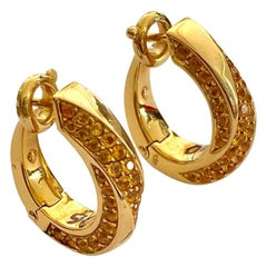 "One '1' Pair of 18 Karat Gold Earrings, Yellow sapphires, ""Mauboussin"", 2000"