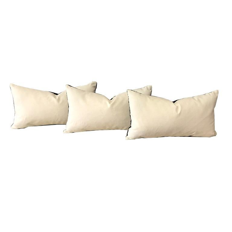 One down filled lumbar pillow in Kelly Wearstler's Wisk in Shadow. Pillow in covered in this Wearstler fabric on the front and in a cream linen on the back. Pillows include a down fill insert and have zipper closure with knife edges.   Custom