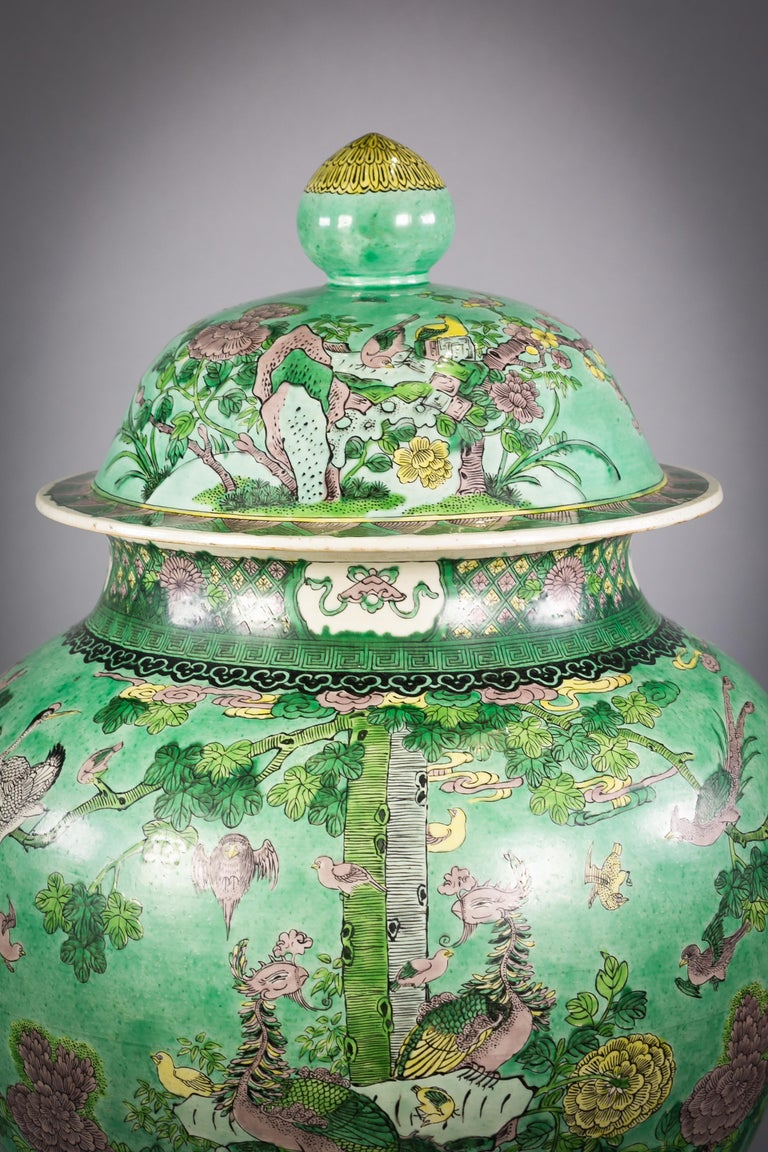 One large Chinese porcelain Famille Verte covered vase on stand, circa 1860.