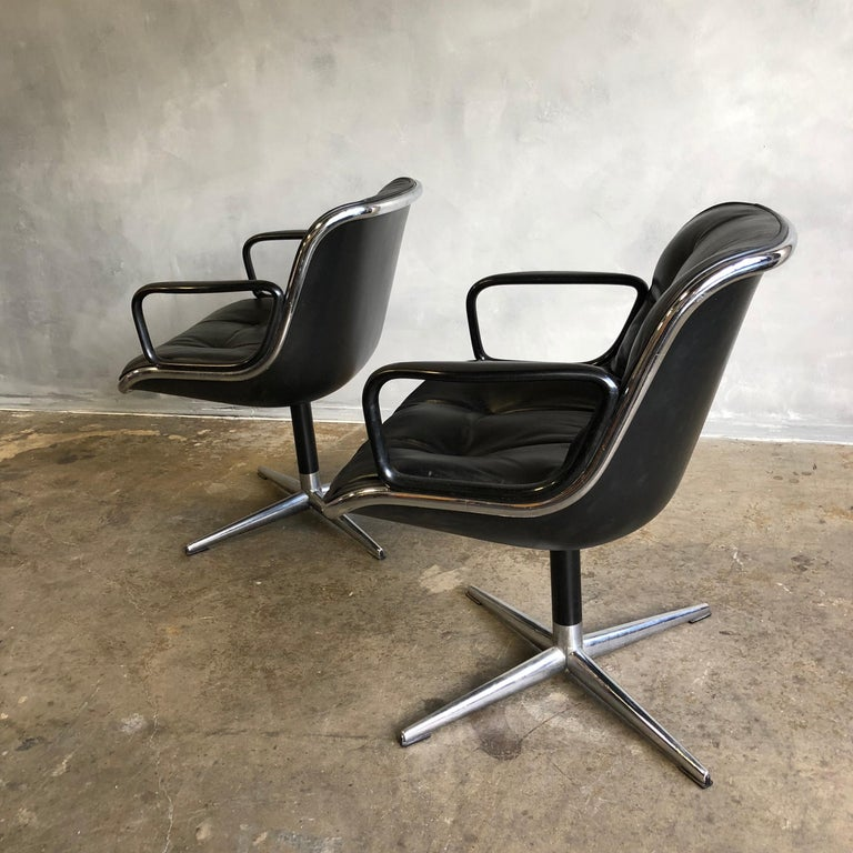 For you consideration is one Charles Pollock for Knoll accent chair. These chairs are icons of Mid-Century Modern design and have been in continuous production by Knoll since their introduction in 1963. The architecture of the single aluminum band