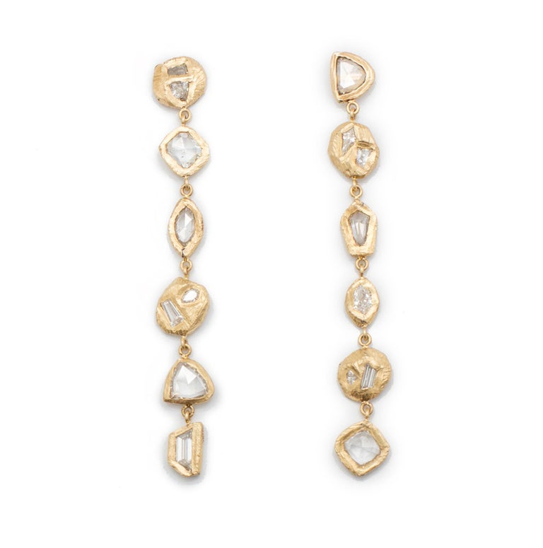 18kt yellow gold earrings with six hand carved settings on either side with 3.16 carats of diamonds.  Handcarved in NYC by artist Page Sargisson. These earrings are truly one of a kind.