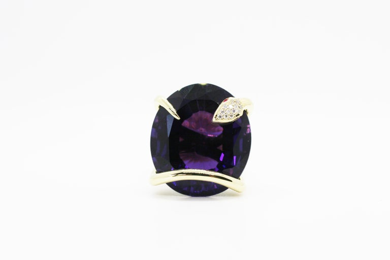 18k Yellow Gold Amethyst Climbing Snake Ring features Perez Bitan's signature curved snake with ruby eyes and white diamond micro pave head that wraps around the finger and sets the natural color changing amethyst in place   18k Yellow Gold,