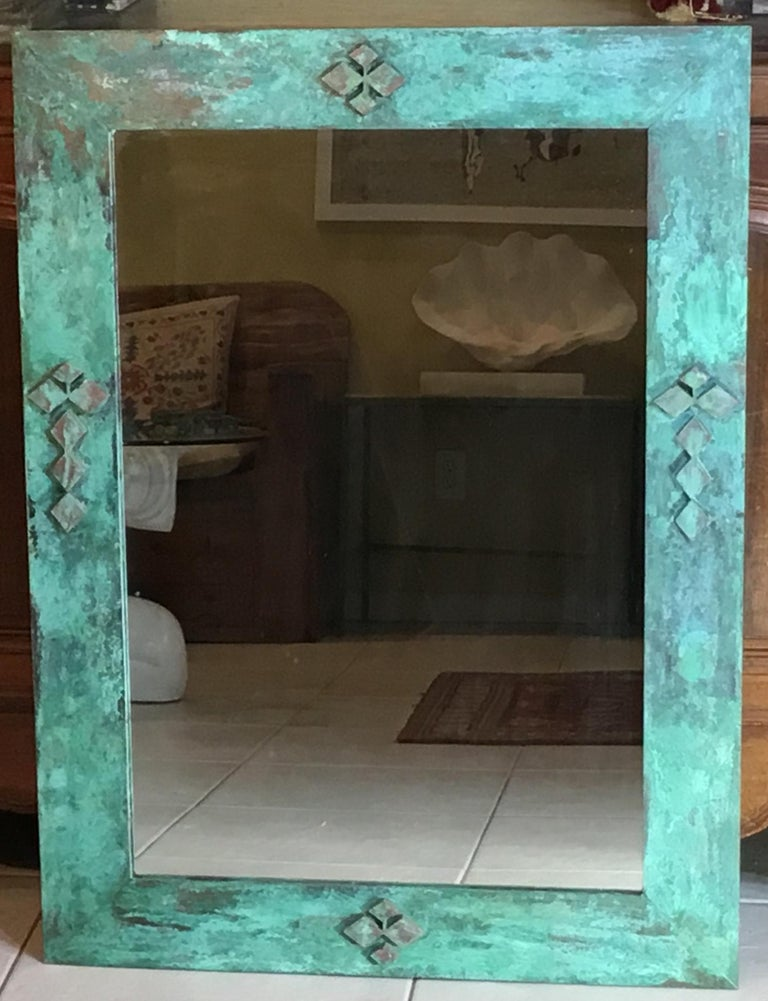Beautiful architectural mirror made of bronze with geometric motifs imbedded in, oxidation of green and turquoise colors enhance the exceptional beauty, use indoor or outdoor.